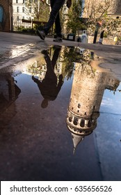 ISTANBUL/TURKEY- APRIL 22,2017: Reflection View of Galata Tower(Turkish: Galata Kulesi) (Galata Kulesi) Christea Turris is a medieval famous landmark stone tower architecture, in beyoglu, Istanbul.