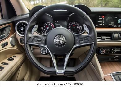 Istanbul/Turkey - April 4 2018 : The New Alfa Romeo Stelvio is the new optimal performance & utility SUV. Alfa Romeo Stelvio 2018 interior close up on driver's seat,  steering wheel and gauges.