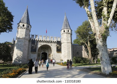 ISTANBUL,TURKEY - AUGUST 15: Tourists entering the Gate of Salutation of Topkapi Palace on August 15,2012, Istanbul, which was the primary residence of the Ottoman Sultans.