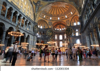 ISTANBUL,TURKEY - AUGUST 15: Tourists visit Hagia Sophia on August 15, 2012 in Istanbul, Turkey. Hagia Sophia is a former Orthodox patriarchal basilica, later a mosque and now a museum.