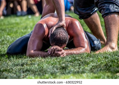 ISTANBUL,TURKEY - August 28, 2016 :Unidentified oil wrestlers.Oil wrestling (Yagli Gures),also called grease wrestling,is Turkish national sport.The wrestlers douse themselves with olive oil.