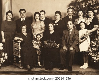 ISTANBUL-Turkey, Circa 1940s : Vintage photo of newlyweds posing with their family and guests.