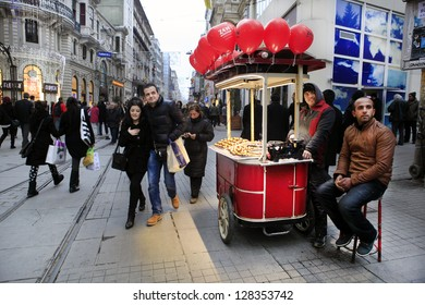 ISTANBUL-TURKEY: FEB 14: Unidentified people walk through the Istiklal Street to celebrate Valentine's Day on February 14, 2013 in Istanbul,Turkey.It's one of the popular destinations in Istanbul.