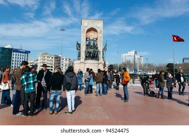 ISTANBUL,TURKEY- FEBRUARY 5: People walk around Republic Monument at Taksim Square on Feb 5, 2012 in Istanbul. The monument honoring the leaders of the struggle for independence was unveiled in 1928.