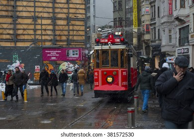 ISTANBUL,TURKEY- January 02: Unidentified pedestrians walk down Istiklal Street on a snowy day on January 02, 2016 in Istanbul, Turkey.Istiklal Street is one of the popular destinations in Istanbul.