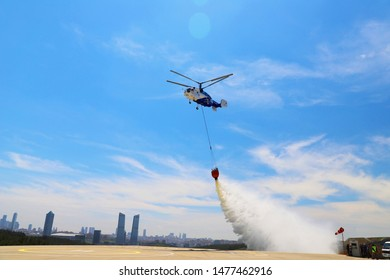 Istanbul/Turkey, July 2019; Helicopter of State Emergency Service is bringing the water in the bucket to extinguish the fire
