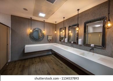 Istanbul,Turkey - July 3, 2018 ;Washbasins and mirrors in public toilet in luxury restaurant. Sofra Kebap Tuzla district Istanbul, Turkey.