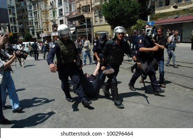 ISTANBUL,TURKEY - JUNE 29 : Anti-NATO demonstration in Istanbul. Protesters arrested by police on June 29, 2004 in Istanbul,Turkey.