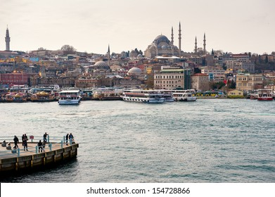 ISTANBUL,TURKEY- MARCH 03: Cruise ferries in Eminonu Port near Yeni Cami and Galata Bridge on March 03, 2013 in Istanbul,Turkey. The Eminonu waterfront is a major dock for ferryboats in Istanbul.