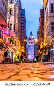 ISTANBUL/TURKEY- MARCH 11,2017: View of old narrow street with the Galata Tower(Turkish: Galata Kulesi) called Christ Tower by Genoese a famous medieval landmark architecture in Istanbul, Turkey.