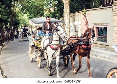 ISTANBUL/TURKEY- MAY 20,2017:Horse carriage in Buyuk Ada(Prince Island). There are beautiful streets and old wooden houses. Phaeton tour is famous.