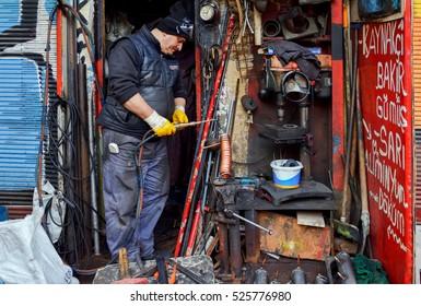 Istanbul,Turkey - November 19,2016 : Welder working in metal workshop - hard-working man