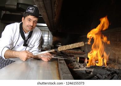 Istanbul/Turkey, November 2018: Turkish kebap eggplant and meatballs/Patlican kebap. Turkish kebap in wood fired oven with kebaps chef.
