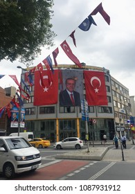 ISTANBUL,TURKEY-5 MAY,2018:National red flag of Turkey in the streets of Istanbul city deocrated for election campaign.Portraits of president Recep Tayyip Erdogan on banners dedicated to elections