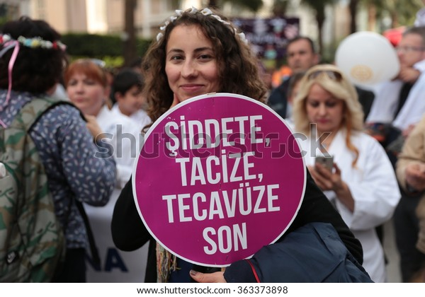 "Istanbul,Turkey-April 04, 2015: Protest against violence against women. In the hands of a woman ""violence, abuse, stop rape"" is carrying the banner."