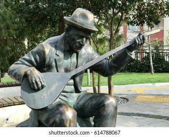 Istanbul,Turkey-April 04,2017:Turkish folk poet statue in Balmumcu Park.Asik Veysel was a Turkish minstrel and highly regarded poet of the Turkish folk literature.He was born in the  province of Sivas