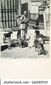ISTANBUL-Turkey,Circa 1900's :Ottoman street vendor.There are around dogs.Circa 1900's.