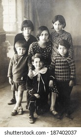 ISTANBUL-Turkey,Circa 1950's :Vintage photo of turkish family looking at camera.