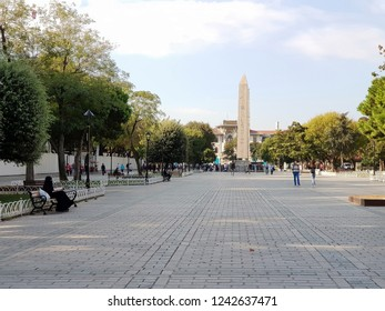 Istanbul,Turkey-Circa September 2018: Old historical column of Egyptian Obelisk stands as the oldest monument and can be seen from a far side as the iconic landmark in Istanbul's Sultanahmet Square.