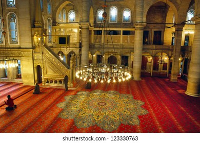 ISTANBUL,TURKEY-DEC 26: Muslims pray inside of Eyup Sultan Mosque on Dec 26,2012 in Istanbul,Turkey. Eyup Sultan is the first mosque constructed by the Ottoman Turks in the city.