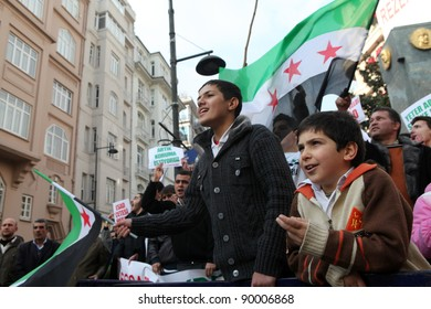 ISTANBUL,TURKEY-DECEMBER 2: Unidentified Syrians living in Istanbul protest the regime of Bashar Essad in front of Syrian Consulate on December 2, 2011 in Istanbul, Turkey.