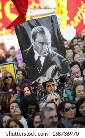 ISTANBUL,TURKEY-DECEMBER 22:Thousands protest against corruption and government on 22 December, 2013 in Istanbul, Turkey. A protester holds a Mustafa Kemal Ataturk's poster.