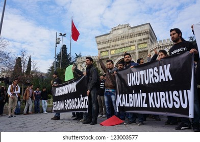 ISTANBUL,TURKEY-DECEMBER 28 : University students staged a protest on the first anniversary of Uludere massacre in front of the Istanbul University on December 28, 2012 in Istanbul,Turkey.