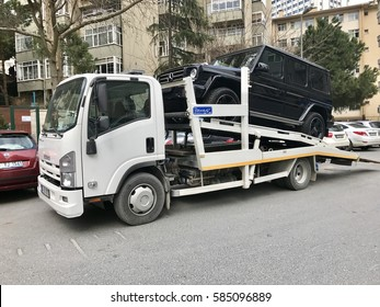 ISTANBUL,TURKEY-FEBRUARY 22,2017:A tow truck picking up a car being badly parked in Istanbul, Turkey