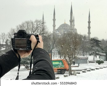 ISTANBUL,TURKEY-JANUARY 08,2017:Turkish photograper  shooting the blue mosque.The Blue Mosque at winter, Istanbul