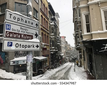 ISTANBUL,TURKEY-JANUARY 09,2017:Taksim Tunnel District street on a snowy day at winter, Istanbul, Turkey