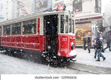 ISTANBUL,TURKEY-JANUARY 8: Unidentified pedestrians walk down Istiklal Street on a snowy day on January 8, 2013 in Istanbul, Turkey.Istiklal Street is one of the popular destinations in Istanbul.