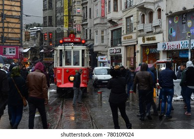 ISTANBUL,TURKEY-JANUARY 8: Unidentified pedestrians walk down Istiklal Street on a snowy day on January 8, 2017 in Istanbul, Turkey.Istiklal Street is one of the popular destinations in Istanbul.