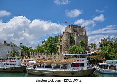 ISTANBUL,TURKEY-JULY 05,2015:Anadolu Hisari (Anatolian Fortress) in Beykoz, Istanbul, Turkey.  The Anatolian fortress was built in 1395 by Yıldırım Beyazıt.There are fishing boats on the creek.