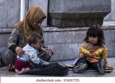 Istanbul,Turkey-June 11, 2016: Syrian refugees living at Istiklal Avenue,known in English as Independence Avenue.These people  fled violence in their country and live their life as homeless in Turkey.
