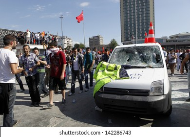 ISTANBUL,TURKEY-JUNE 1:After two days of clashes police withdrew from Taksim and allowed protesters in on june 1, 2013 in Istanbul,Turkey.Protesters looking at a damaged police car.