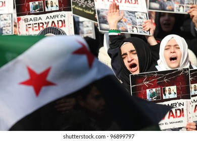 ISTANBUL,TURKEY-MARCH 2:A group of unidentified people stage a demonstration in front of the Beyazit Mosque, protesting Syrian authorities' violent crackdown in Homs on March 2,2012 in Istanbul,Turkey