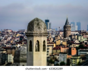 ISTANBUL,TURKEY-MAY 05,2017:View of galata tower  from courtyard of Suleymaniye Mosque through domes of madrasas, Istanbul, Turkey