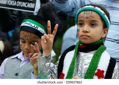 ISTANBUL,TURKEY-MAY 29: Unidentified children participate a demonstration protesting Syrian authorities' violence , on May 29, 2012 in Istanbul, Turkey