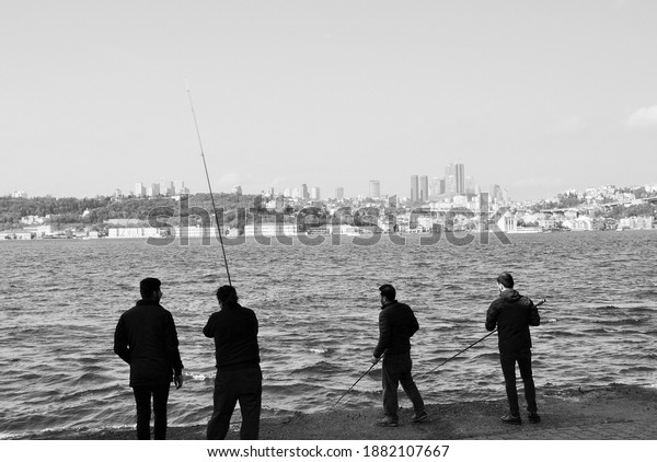 Istanbul,Turkey,November 2017, fishermen and a view to the city