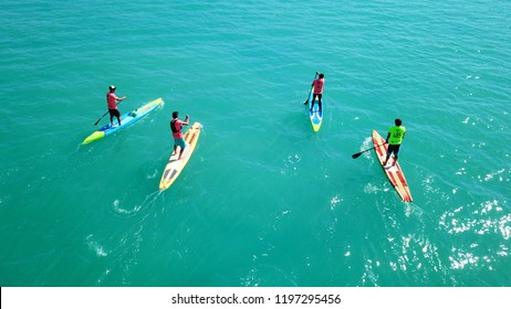 Isthmos or Isthmus, Peloponnese / Greece - October 07 2018: Aerial bird's eye view photo taken by drone of stand up paddle surfers in SUP competition in Corinth Canal