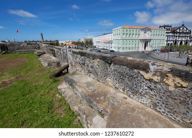istorical fortification wall with cannon display in city center of Ponta Delgada, Azores