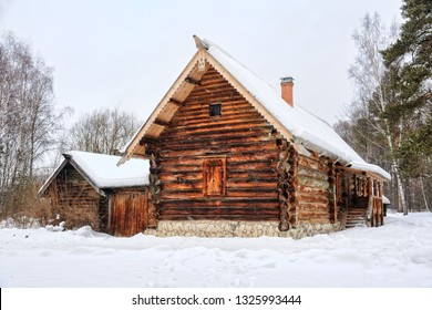 ISTRA, MOSCOW REGION, RUSSIA - Covered snow old peasant farm of Kokorins from Vykhino of Lyubertsy District on the grounds of the Museum of Wooden Architecture.