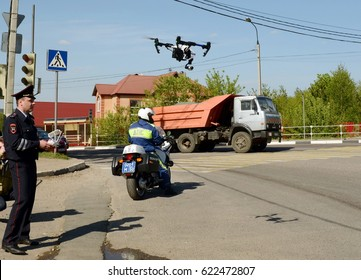 ISTRA, RUSSIA - MAY 14,2016:The inspector of traffic police services monitors the route using the quadcopter.