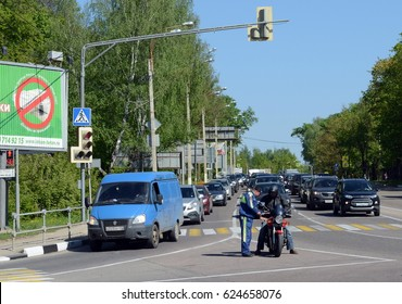 ISTRA, RUSSIA - MAY 14,2016:The officer checks police motorcyclist on a city street.