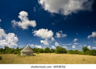 Istrian kazun under the white clouds