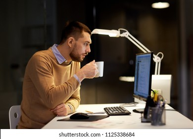 it, deadline and people concept - man with cup of coffee working on computer code at night office