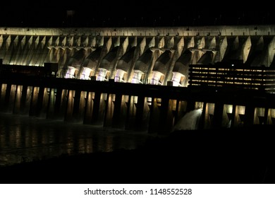 The Itaipu Dam - the biggest hydroelectric dam on the Parana River located on the border between Brazil and Paraguay. Beautiful night view with low lights.