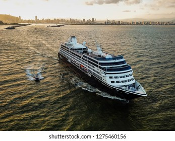 Itajai, Santa Catarina / Brazil - 01 02 2019: Followed by a pilot boat, the cruise ship AZAMARA PURSUIT resumes her voyage to Uruguay, Argentina, the Falklands and Antarctica