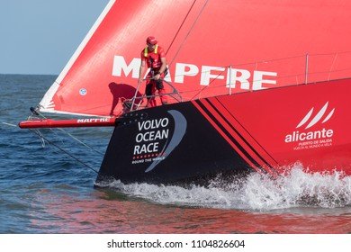 Itajai, Santa Catarina / Brazil - 04 22 2018: Volvo Ocean Race - A crew member stands on Desafio Mapfre's bow to ready the boat to open sea race condition