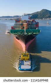 "Itajai, Santa Catarina / Brazil - 05 31 2018: the containership ""UASC UMM Qasr"" sails up the Itajai-Acu River with the aid of tugs"